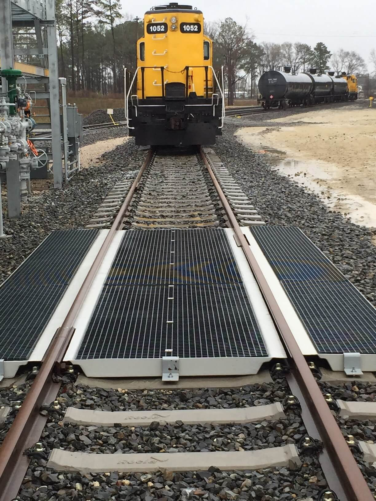 Polystar Containment Star Track fiberglass track pans with pedestrian fiberglass grating