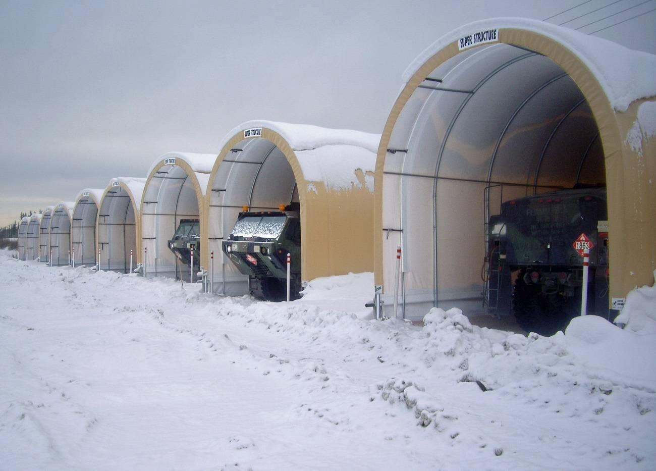 camel tri star max containment systems with canopies in the snow