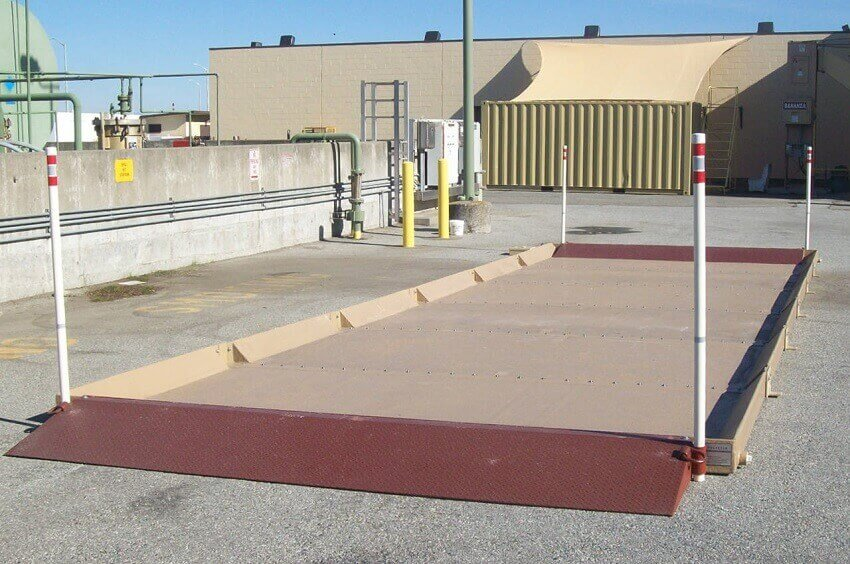 camel tri star modular containment system installed on concrete lot