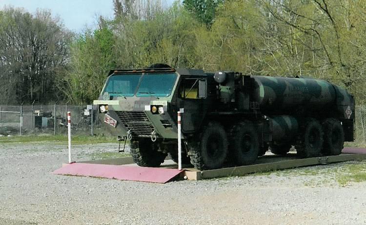 truck sitting on camel tri star system