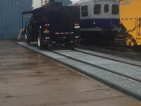 Truck on heavy duty galvanized steel track pans for Polystar Containment Star Track Spill Containment System