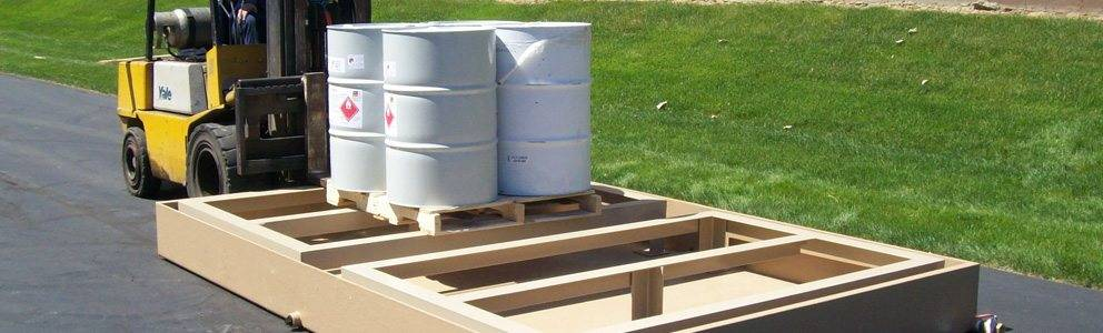 portable spill containment system transported with material barrels