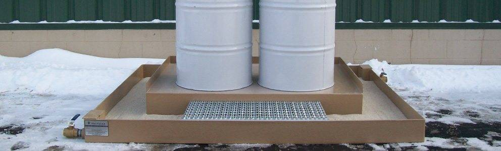 material barrels on spill containment system