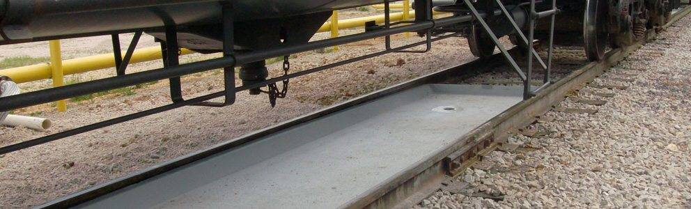 railcar spill prevention system assembly