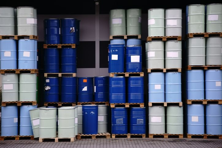 RCRA hazardous waste in blue and gray storage barrels